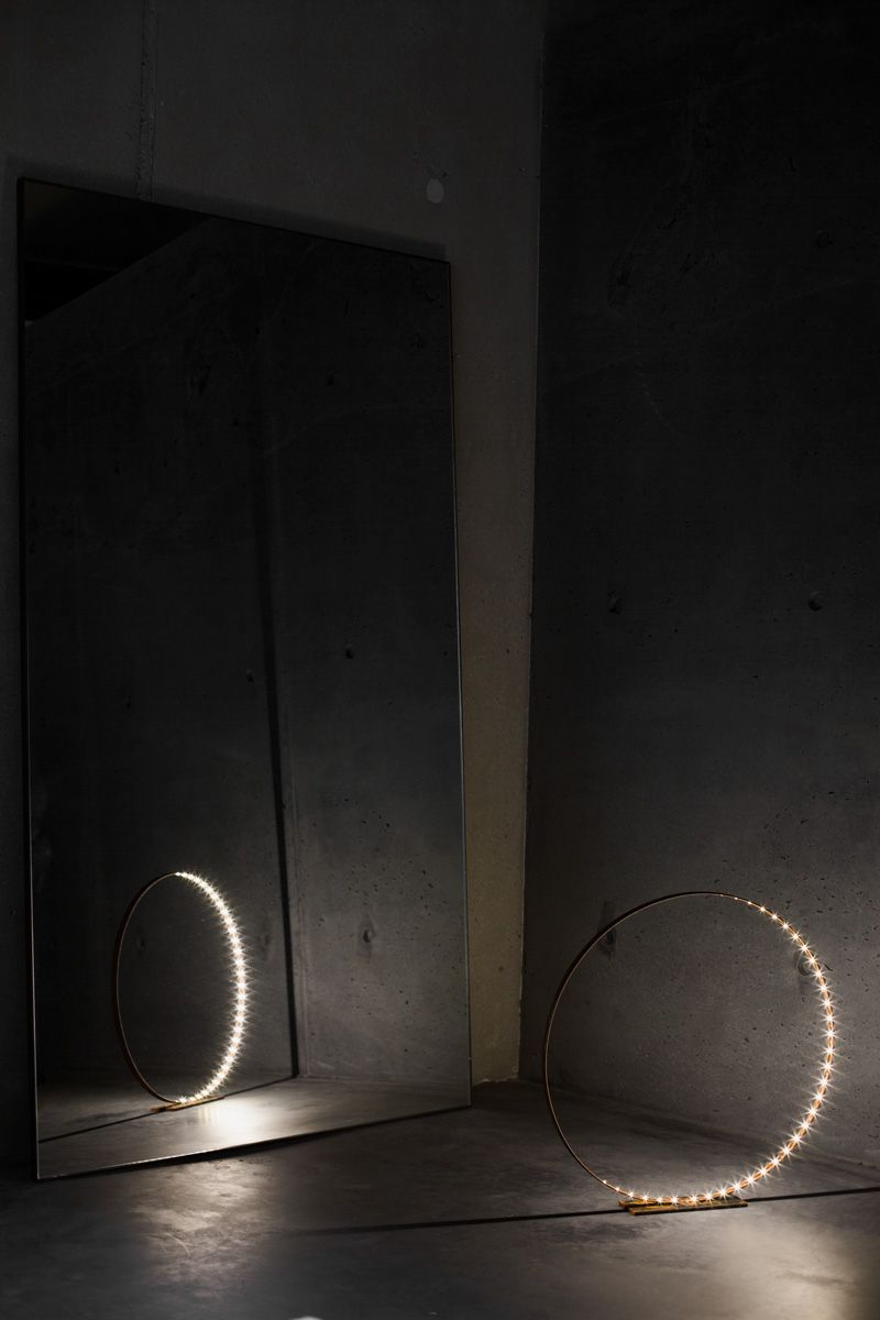 A photograph of Silhouet Lighting Circle with mirror and concrete at ETQ Store by Poppyonto