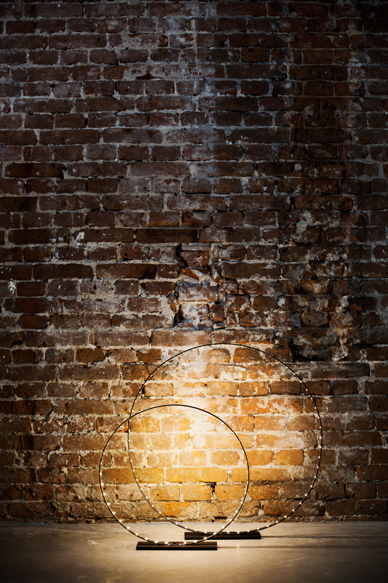 A photograph of Silhouet Lighting Circle in front of a brick wall at Trust Amsterdam by Poppyonto