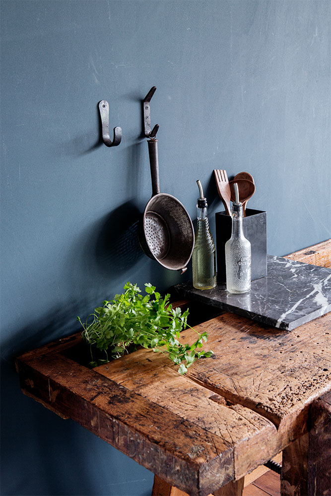 campaign photography Brut Amsterdam color blue wall hooks kitchen by Poppyonto